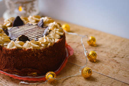Delicious chocolate cake covered with chocolate chips and topped with a buttercream decoration Reklamní fotografie
