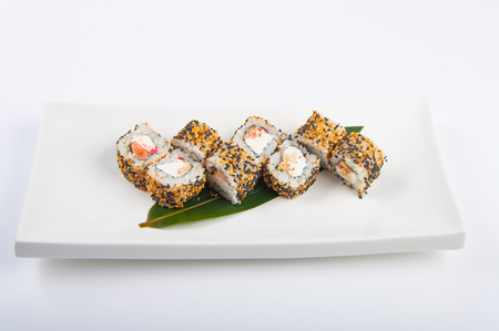 sushi roll with salmon, cream cheese, scrambled eggs, sesame