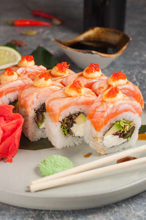 tasty sushi rolls with salmon, cream cheese and avocado Stock Photo