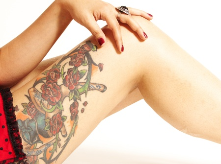 Tattooed Pinup Girl Legs and Hand Stock Photo - 8997660