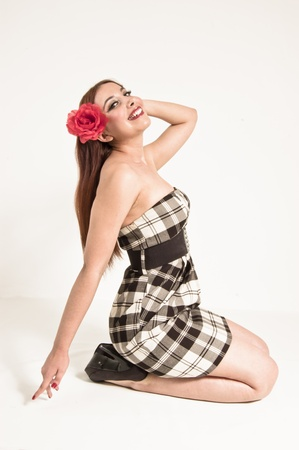knees up: Pinup Girl Sitting on the Floor Hand Up