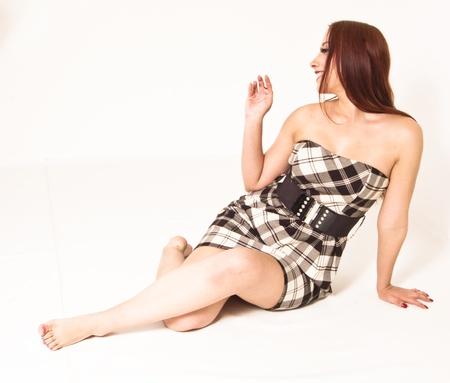 knees up: Pinup Girl Sitting on the Floor Saying Hello