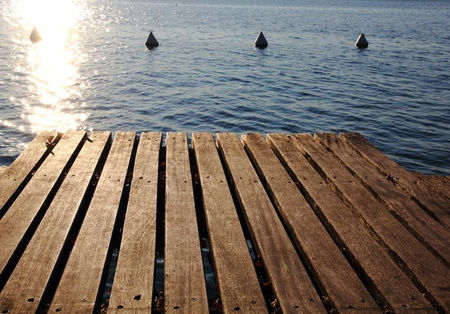 jetty on a lake photo