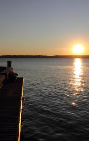 sunset on a lake photo