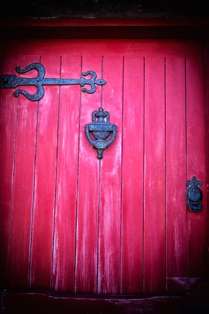 red door: a detail of a red door Stock Photo