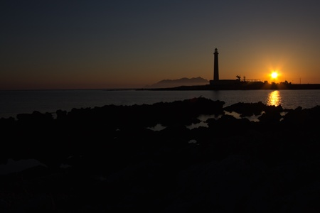 sunrise ocean: a view of the Favignana lighthouse Sicily,Italy