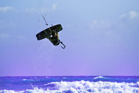 20 30: A Kiteboarder makes free style on the waves in Capo Miseno, Italy.