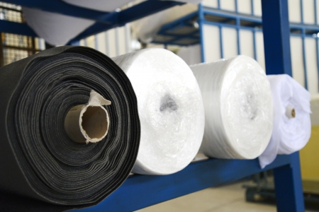 fabric roll: Fabric rolls in a factory Stock Photo