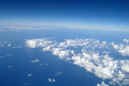 Clouds and blue sky seen from plane