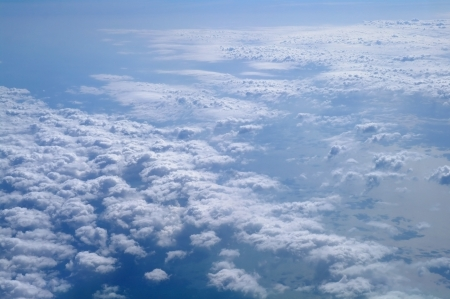 Clouds and blue sky seen from plane  photo