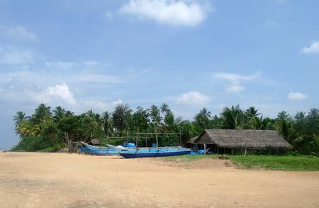 Exotic fisherman boat on beach near the ocean photo
