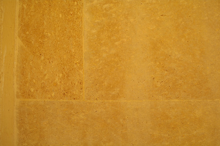 yellow stone: old yellow stone wall texture