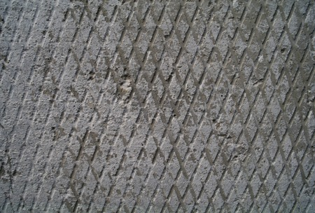 groove: abstract cement tile texture diagonal groove pattern macro closeup . Stock Photo