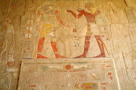 Egyptian hieroglyphs in the Queen Hatshepsut temple in Egypt.
