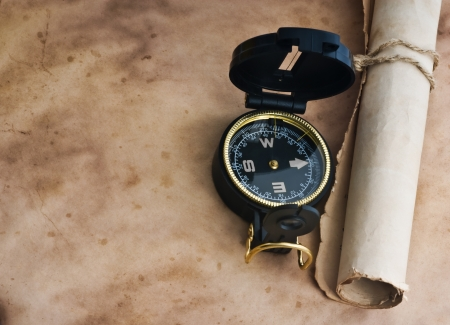 old compass on grunge background photo