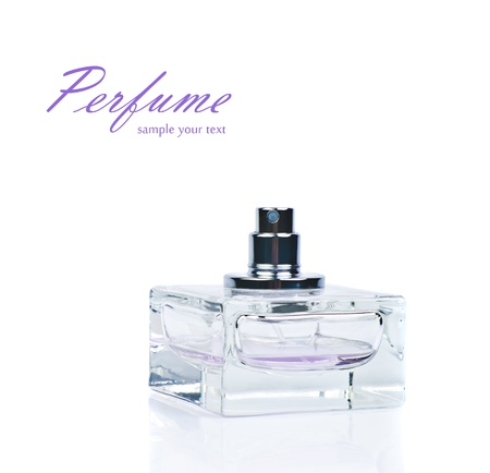transparent bottle of pink perfume isolated photo
