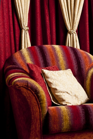 pillow with an ornament on a red chair photo