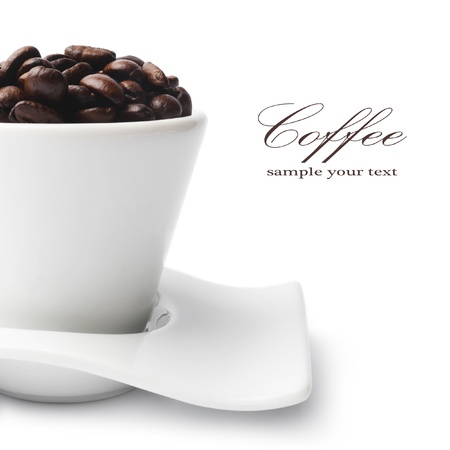 instant coffee: coffee beans in a cup isolated on white background
