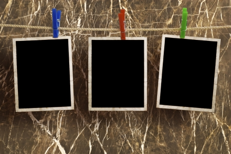 old photograph: Film Blanks Hanging on a Rope Held By Clothespins  Stock Photo