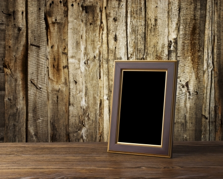 photo frame on old wooden table photo