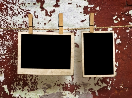 Film Blanks Hanging on a Rope Held By Clothespins on a Grunge Background photo