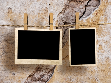 Film Blanks Hanging on a Rope Held By Clothespins on a Grunge Background Standard-Bild