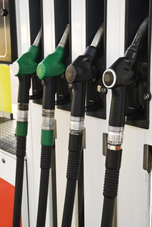 Pump nozzles at the gas station  selective focus  Stock Photo - 15720900