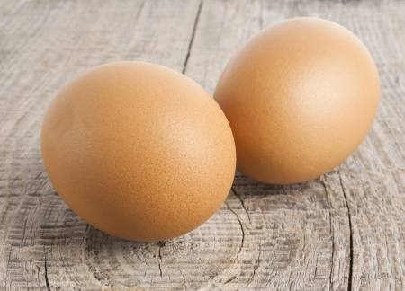 Eggs on wooden background photo