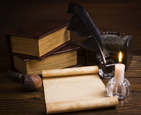 old papers and books on a wooden table photo