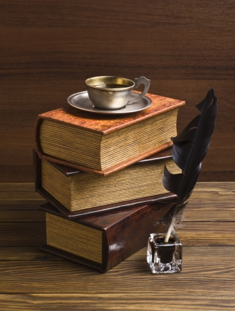 old books and pen on a wooden table Stock Photo