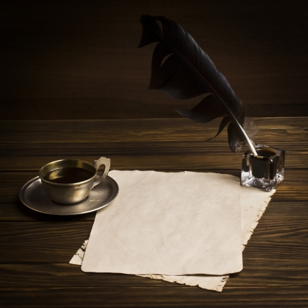 Blank paper and cup of coffee, quill   ink