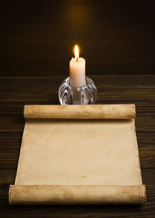 Old paper with a candle photo