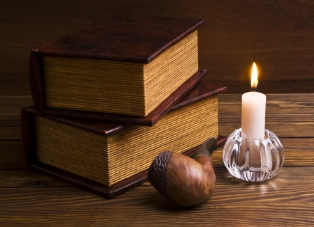 ancient books with candle photo