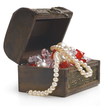 open treasure chest with jewelry isolated on white Stock Photo