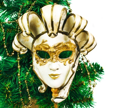 Christmas decoration with tree and carnival mask  photo