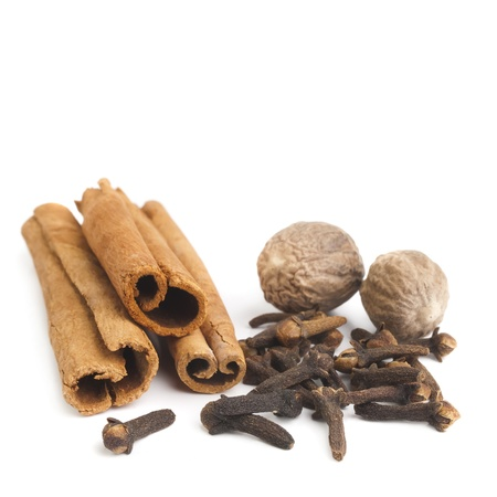 monkey nuts: cloves and cinnamon sticks on white Stock Photo