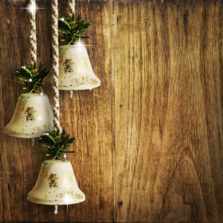 bells on wooden wall photo