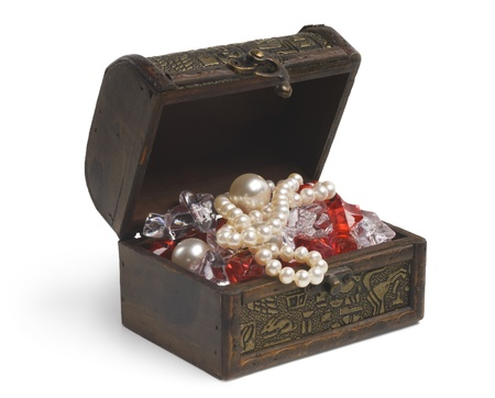 open treasure chest with jewelry isolated on white photo