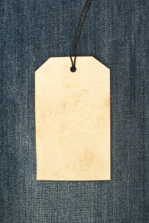 Vintage paper tag on blue denim photo