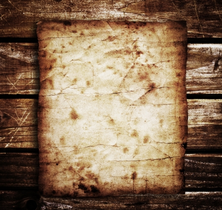 old paper on brown wood texture with natural patterns Stock Photo - 17285175