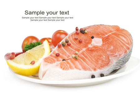 Salmon steak with lemon, pepper and parsley photo