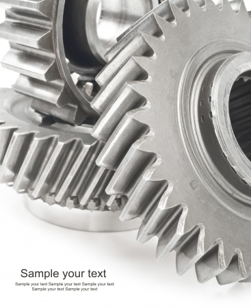 real stainless steel gears isolated over white background photo