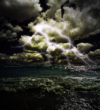 lightnings in dark sky, stormy sea photo
