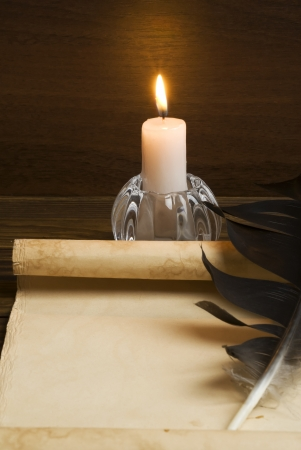 Old paper with a candle Stock Photo - 22925458