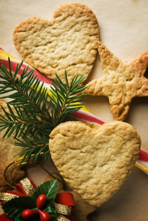 Christmas Ginger cookies with fir tree brancheson the wrapping paper background  photo