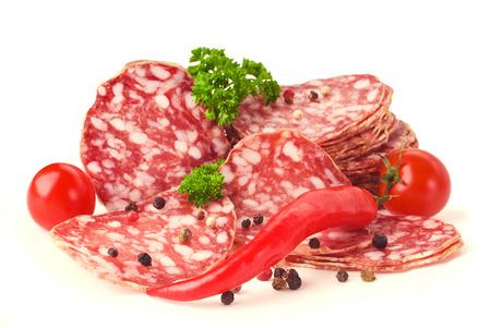 sliced salami isolated on white photo