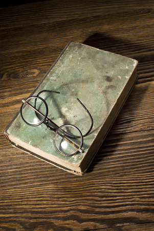 very dirty: old book on wooden table Stock Photo