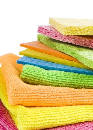 Brightly colored sponges on white background with copy space  photo