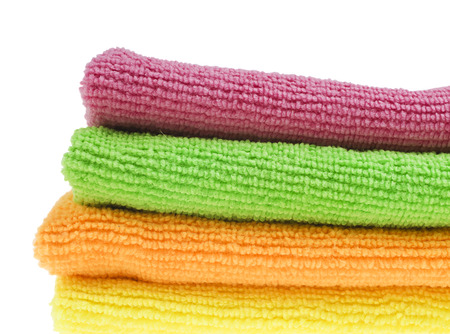 Brightly colored sponges on white with copy space