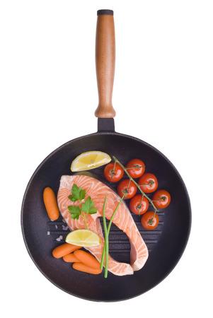 salmon steaks in the iron pan photo